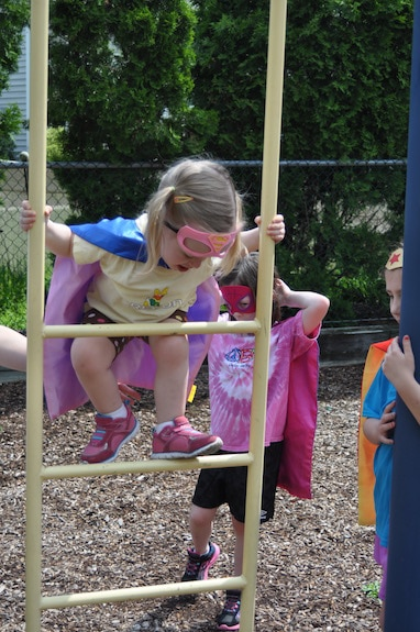 Climbing up, up, up is a fun workout for little legs in this Superhero Playground Challenge!