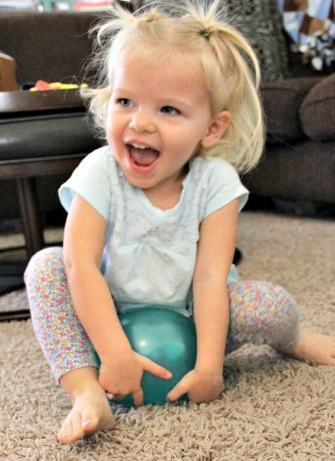 Such a silly gross motor balloon activity that gets kids bouncing, jumping, and rolling on balloons!