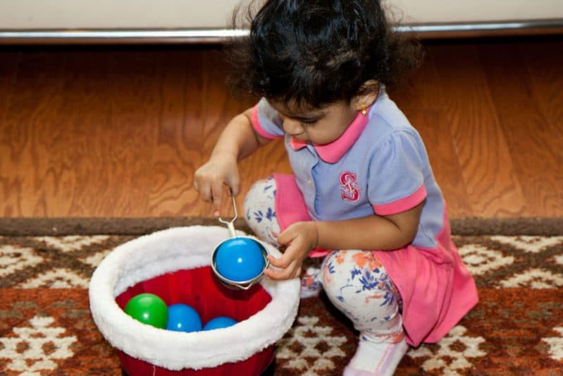 This scoop and transfer activity looks would keep a toddler busy for hours!
