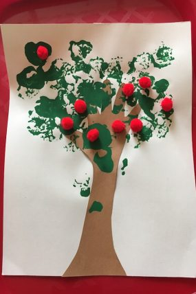 This Handprint Apple Tree craft is a super simple way to welcome fall!