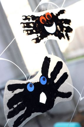 Make a spider handprint window cling with with the kids! Such a cute Halloween decoration!