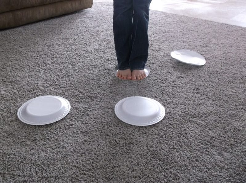 Practice rock hopping skills using paper plates