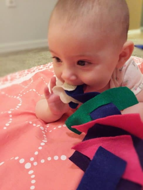 Explore the sense of touch and practice fine motor skills with a fun baby felt play activity.