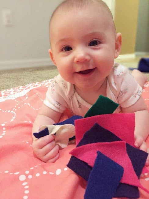 Use a fun baby felt play activity to explore touch and build fine motor skills!