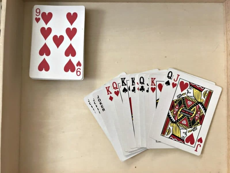 Pull out the Jacks, Queens, and Kings. Leave Aces through 10 in the deck.