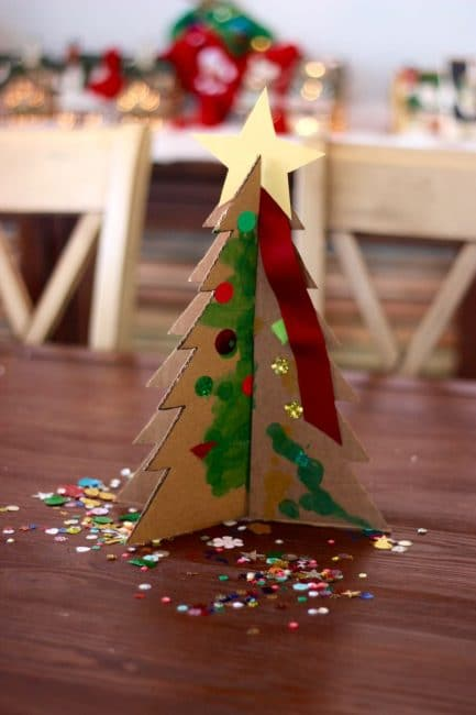 Let your kids help decorate with an easy tabletop Christmas tree activity.