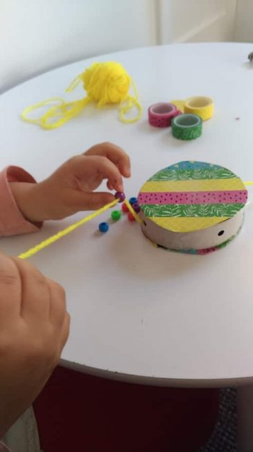 Add beads to your DIY hand drum