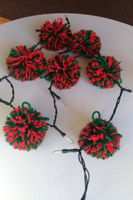 Add some extra cuteness to your Christmas lights with homemade pom poms. It's a great way to strengthen those preschooler fingers, too!