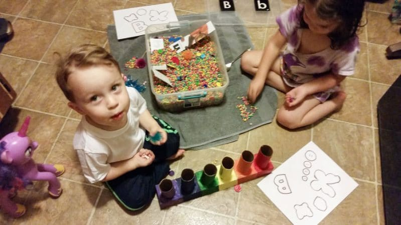 Use sensory items, books, and printables to help your preschool aged children learn letters.