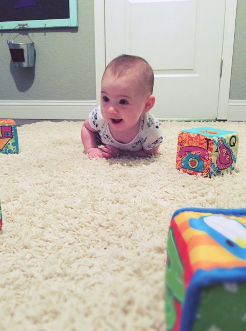 Crawl and learn with your baby to develop gross motor skills