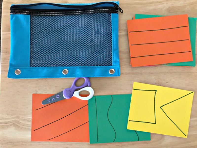 Make a super simple busy bag to practice cutting.