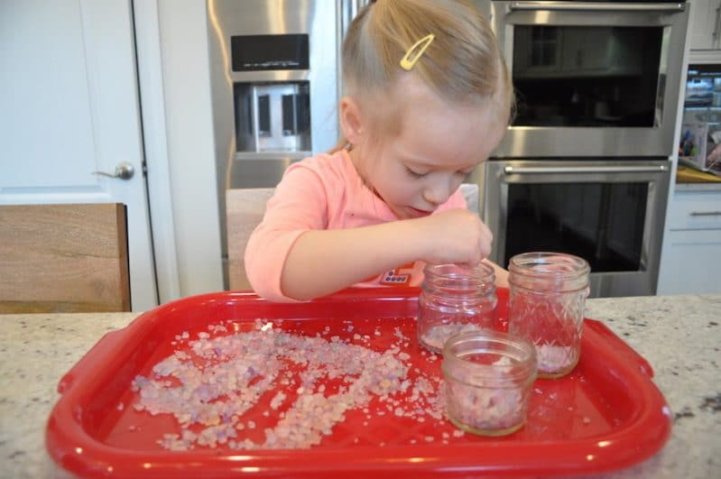 Your preschooler will love sensory play with DIY rainbow salt.