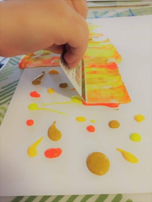 Create a colorful Fall painting with this easy Autumn landscape art activity. This scrape painting technique is simple enough for toddlers and preschoolers!