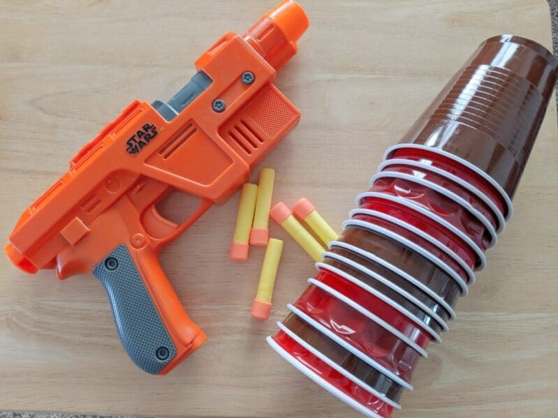 Cups + Nerf guns. That's all you need to a great hand-eye coordination game!