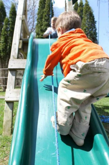 developing gross motor skills with a slide