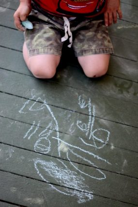 Preschooler Drawing with Sidewalk Chalk