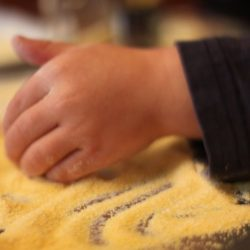 Corn meal sensory bin for kids