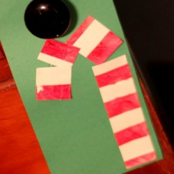 Tape Resist Candy Cane, 1 of the 25 easy Christmas crafts for kids