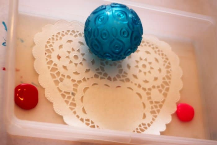 Painted doily hearts for Valentine window