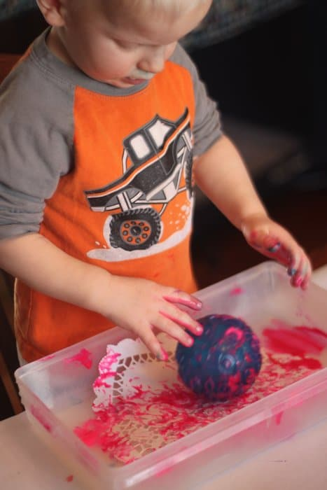 Toddler Painted doily hearts for Valentine window
