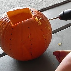 Drilling holes in pumpkins.