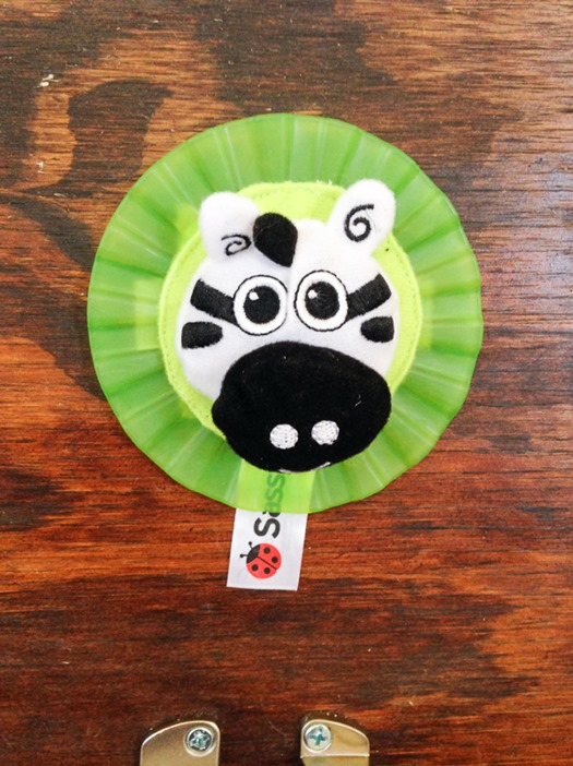 Reuse old toys for toddler busy board