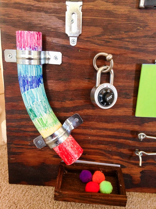 Colored PVC pipe and padlocks for toddler busy board