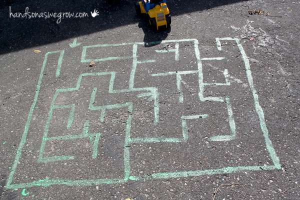 Your preschooler will love to drive cars and trucks around their big chalk maze!