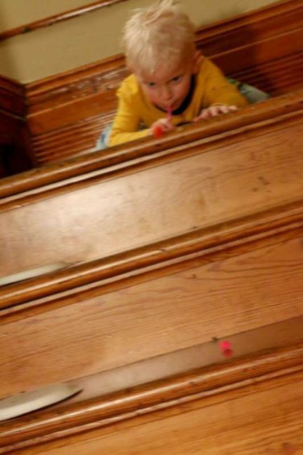 Blowing pom poms down the stairs