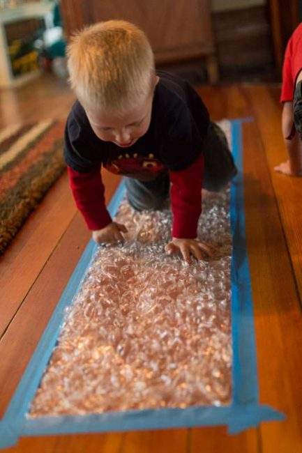 Classroom Ideas For 1 Year Olds ~ Make a bubble wrap runway hands on as we grow