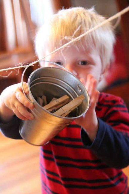 Bucket and clothesline activity for toddlers