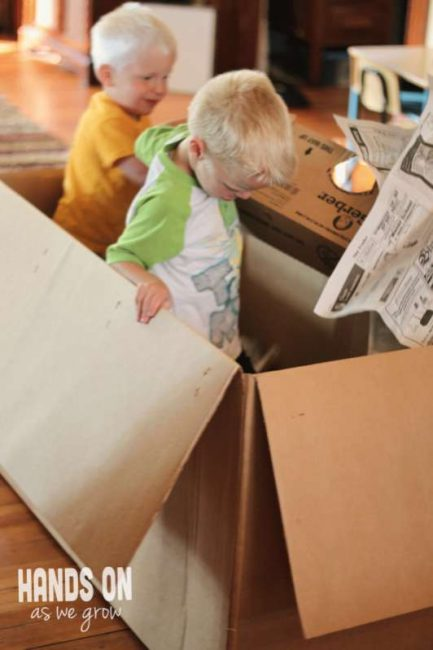 Make a Cardboard box dumpster for the kids to dive in and find treasures.