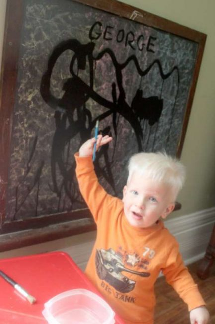 Painting on the chalkboard with water.