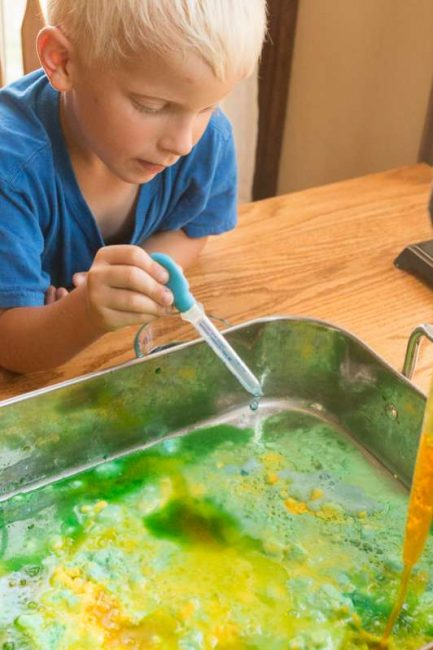 Using colored vinegar to see eruptions in baking soda (and mixing colors!)