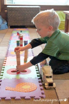 Counting blocks while building towers using the ABC mat