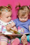 http://www.dreamstime.com/royalty-free-stock-photography-two-toddlers-reading-together-image20778707