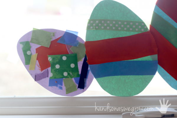 Most of the Easter egg craft hanging in the window