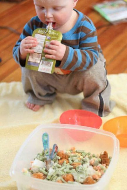 Edible sensory play with frozen veggies for babies and toddlers with baby food too.