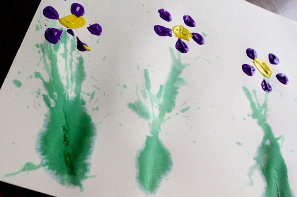 Spring Flower Art Project for Kids to Create -- bottle prints and straw blown stems