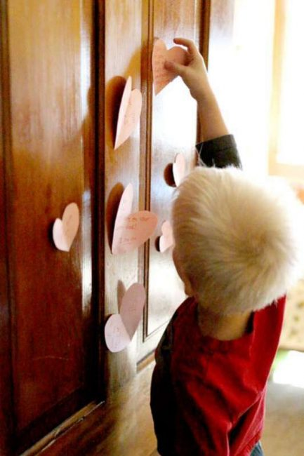 Hang the hearts from the Valentine's scavenger hunt on bedroom door - a new heart every day