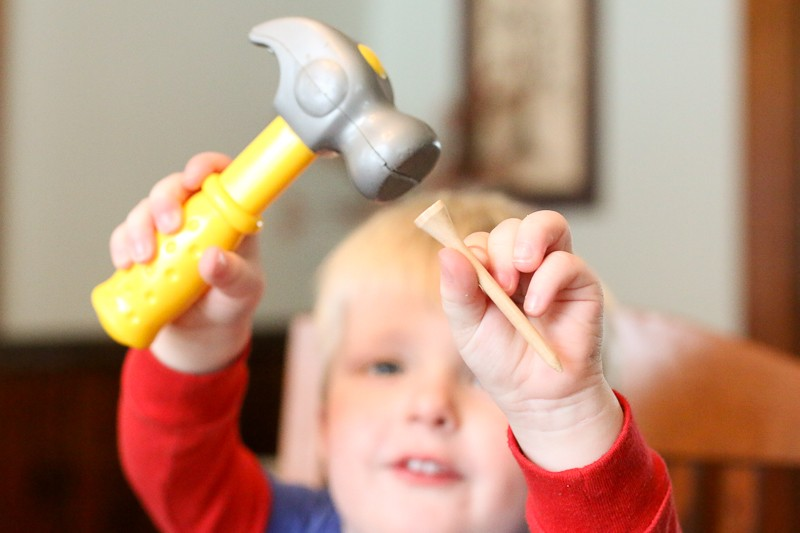 A hammer and tee activity to practice hand and eye coordination