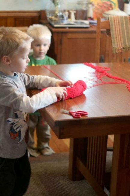 Measuring and cutting the string for the heart garland
