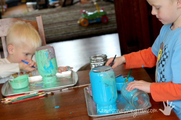 The kids painting and learning how to tint Mason jars