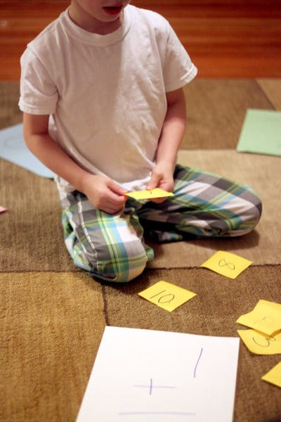 A Kindergarten math activity that gets them moving while solving simple addition problems.