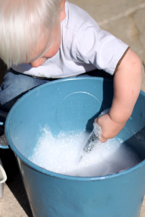 Making bubbles and playing with them - simple toddler sensory activity