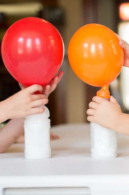 Blowing up balloons with a gas (not helium!) - one of 10 hands-on science & math activities for the kids to LOVE!