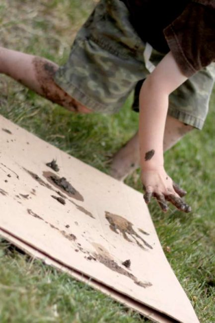 Playing in the mud making prints