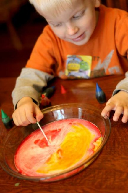 Magically make orange with the color changing milk experiment!