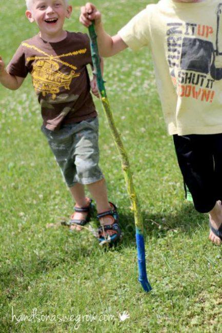 Kids making their own walking sticks for summer walks