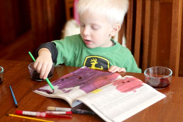 Painting newsprint [phonebooks] with watercolors to make hearts